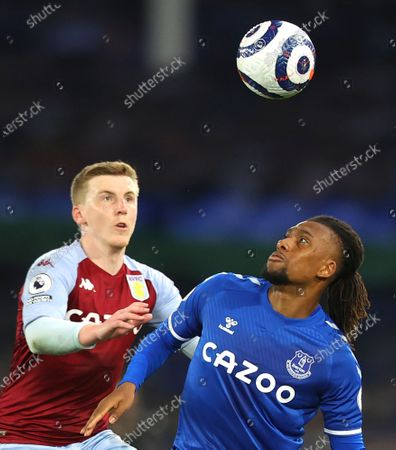 Aston Villa's Matt Targett, left, and Everton's Alex Iwobi challenge for the ball during the English Premier League soccer match between Everton and Aston Villa at Goodison Park in Liverpool, England