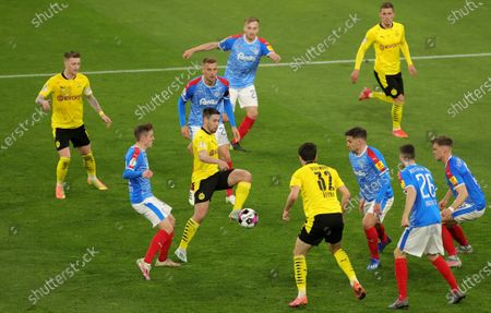 Stock Image of Dortmund's Raphael Guerreiro (C) in action during the German DFB Cup semi final soccer match between Borussia Dortmund and Holstein Kiel in Dortmund, Germany, 01 May 2021.