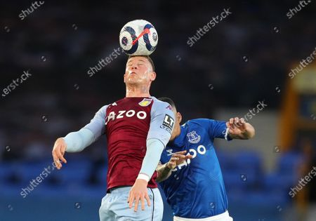 Ross Barkley (L) of Aston Villa wins the header during the English Premier League soccer match between Everton FC and Aston Villa in Liverpool, Britain, 01 May 2021.
