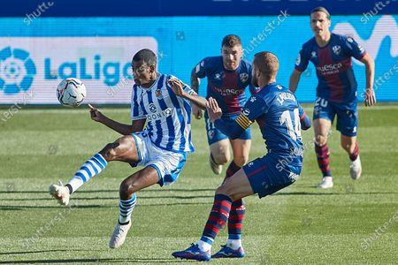 Stock Picture of Alexander Isak of Real Sociedad, Jaime Seoane, Javi Galan and Jorge Pulido of SD Huesca
