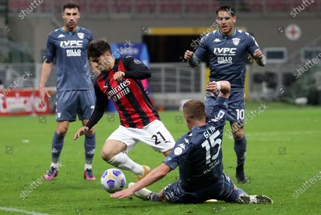 Milan's Brahim Diaz (2-L) in action against Benevento's Kamil Glik (2-R) during the Italian Serie A soccer match between AC Milan and Benevento Calcio at Giuseppe Meazza stadium in Milan, Italy, 01 May 2021.