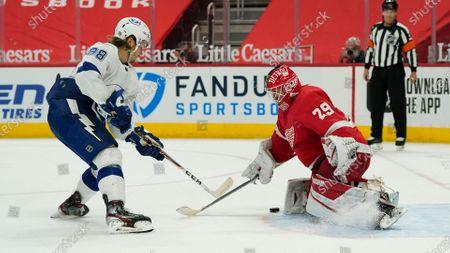Detroit Red Wings goaltender Thomas Greiss (29) stops a Tampa Bay Lightning defenseman Mikhail Sergachev (98) shot during a shootout in an NHL hockey game, in Detroit. Detroit won 1-0