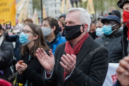 LONDON, UNITED KINGDOM - May 01, 2021: Labour Party MP and former Shadow Chancellor John McDonnell joins demonstrators in Trafalgar Square in central London for 'Kill the Bill' protest  to oppose government's Police, Crime, Sentencing and Courts Bill (PCSC Bill), which would give police officers and the Home Secretary new powers to impose conditions on protests and public processions, on 01 May, 2021 in London, England. The protest organised by a coalition of different groups including Black Lives Matter and Women's Strike Assembly is part of a national day of action with at least 46 protests happening across the UK on International Workers' Day.