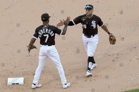 Chicago White Sox's Tim Anderson (7) and Leury Garcia celebrate the team's 7-3 win over the Cleveland Indians in a baseball game, in Chicago. Anderson and Garcia accounted for all the White Sox runs