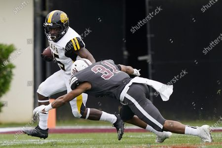 Stock Picture of Arkansas-Pine Bluff running back Mattias Clark (45) evades a tackle attempt by Alabama A&M safety Jonathan Struggs (31) during the second half of the Southwestern Athletic Conference Championship NCAA college football game, in Jackson, Miss. Alabama A&M won 40-33