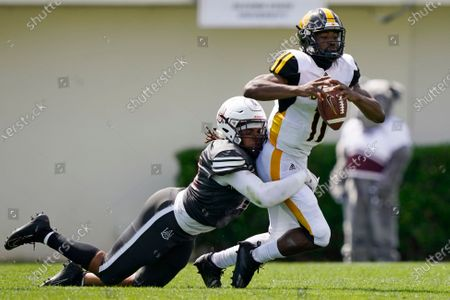 Stock Photo of Arkansas-Pine Bluff quarterback Skyler Perry (11) is sacked by Alabama A&M defensive end Marcus Cushnie during the first half of the Southwestern Athletic Conference championship NCAA college football game, in Jackson, Miss. Alabama A&M won 40-33