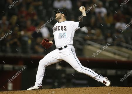 Stock Image of Arizona Diamondbacks' Alex Young delivers a pitch against the Colorado Rockies, in Phoenix