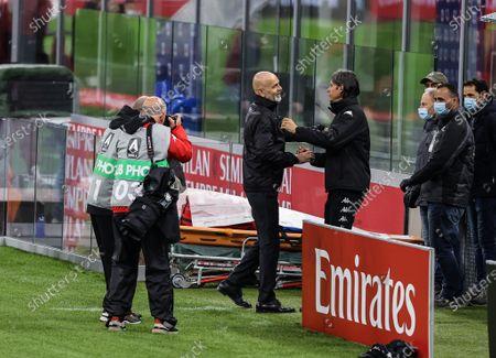 Head Coach of AC Milan Stefano Pioli and Head Coach of Benevento Calcio Filippo Inzaghi
