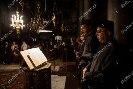 Cantors sing hymns during the Easter Resurrection Service with limited attendance as part of the measures to prevent the spread of the coronavirus, conducted by the Ecumenical Patriarch Bartholomew I, the spiritual leader of the world's Orthodox Christians, at the Patriarchal Cathedral of St. George in Istanbul, late