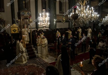 Ecumenical Patriarch Bartholomew I, on the throne left, the spiritual leader of the world's Orthodox Christians, conducts the Easter Resurrection Service with limited attendance as part of the measures to prevent the spread opf the coronavirus, at the Patriarchal Cathedral of St. George in Istanbul, early