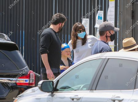 Stock Picture of Ben Affleck and Jennifer Garner seen with their son, Samuel Affleck, at swim lessons