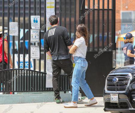 Ben Affleck and Jennifer Garner wait outside their son's swim lessons