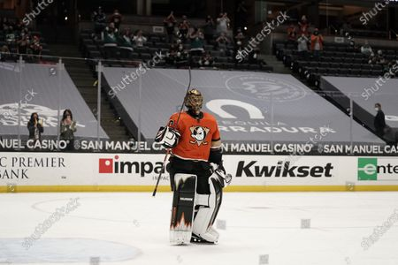 Playing his last home game, Anaheim Ducks goaltender Ryan Miller acknowledges fans during the first period of the team's NHL hockey game against the Los Angeles Kings, in Anaheim, Calif. Miller will retire at the conclusion of the season