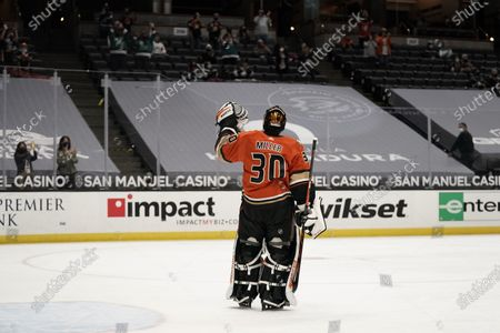 Playing his last home game, Anaheim Ducks goaltender Ryan Miller acknowledges the fans during the first period of the team's NHL hockey game against the Los Angeles Kings, in Anaheim, Calif. Miller will retire at the conclusion of the season, ending an 18-year career