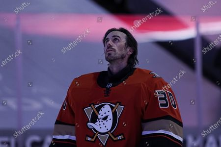Anaheim Ducks goaltender Ryan Miller listens to the national anthem before the team's NHL hockey game against the Los Angeles Kings, in Anaheim, Calif. Miller will retire at the conclusion of the season, ending the 18-year career of the winningest American-born goaltender in NHL history