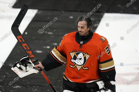 Anaheim Ducks goaltender Ryan Miller acknowledges fans after the team's NHL hockey game against the Los Angeles Kings, in Anaheim, Calif. Miller, who is retiring at the conclusion of the season, was playing in his last home game