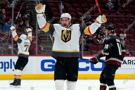 Stock Picture of Vegas Golden Knights right wing Mark Stone, middle, and center William Karlsson (71) celebrate an overtime goal by Jonathan Marchessault, as Arizona Coyotes center Christian Dvorak (18) skates past, at an NHL hockey game, in Glendale, Ariz. The Golden Knights won 3-2