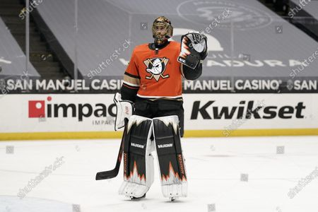 Playing his last home game, Anaheim Ducks goaltender Ryan Miller acknowledges the fans during the first period of an NHL hockey game against the Los Angeles Kings, in Anaheim, Calif. Miller will retire at the conclusion of the season, ending the 18-year career of the winningest American-born goaltender in NHL history