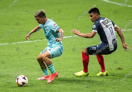 Jesus Gallardo (R) of Monterrey in action against Daniel Amador (L) of Mazatlan during the Liga MX Guard1anes Clausura Tournament 2021 Tournament soccer match, at the BBVA stadium in Guadalupe, Mexico, 01 May 2021.