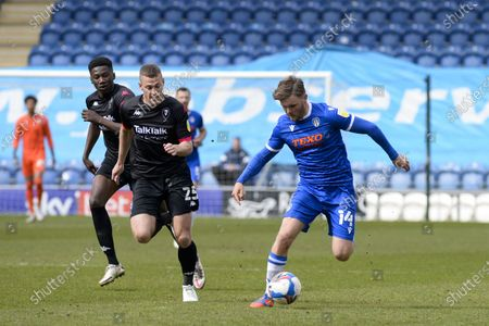 Colchesters Noah Chilvers and Salford Citys Paul Coutts during the Sky Bet League 2 match between Colchester United and Salford City at the Weston Homes Community Stadium, Colchester on Saturday 1st May 2021.