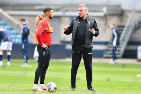 Bristol City manager Nigel Pearson talking to Nahki Wells of Bristol City before the Sky Bet Championship match between Millwall and Bristol City at The Den, London on Saturday 1st May 2021.