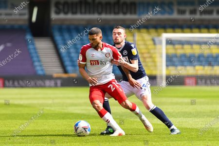 Nahki Wells of Bristol City battles for possession with Scott Malone of Millwall during the Sky Bet Championship match between Millwall and Bristol City at The Den, London on Saturday 1st May 2021.