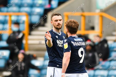 Scott Malone of Millwall celebrates after scoring his team's second goal with Tom Bradshaw of Millwall during the Sky Bet Championship match between Millwall and Bristol City at The Den, London on Saturday 1st May 2021.