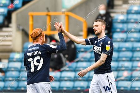 Stock Photo of Scott Malone of Millwall celebrates after scoring his team's second goal with Ryan Woods of Millwall during the Sky Bet Championship match between Millwall and Bristol City at The Den, London on Saturday 1st May 2021.