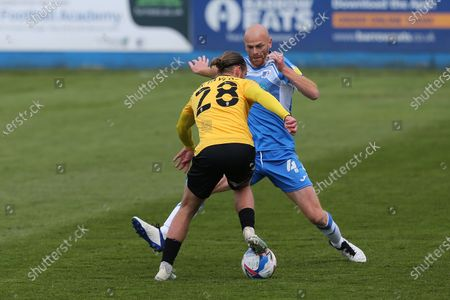 Kyle Taylor of Southend United in action with Jason Taylor of Barrow   during the Sky Bet League 2 match between Barrow and Southend United at  Holker Street, Barrow-in-Furness on Saturday 1st May 2021.