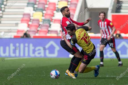 Saman Ghoddos of Brentford and Craig Cathcart of Watford battle for the ball during the Sky Bet Championship match between Brentford and Watford at the Brentford Community Stadium, Brentford on Saturday 1st May 2021.