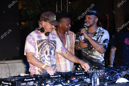 Thomas Wesley Pentz, known as Diplo, from left, Cuba Gooding Jr. and Leighton Paul Walsh, known as Walshy Fire in concert