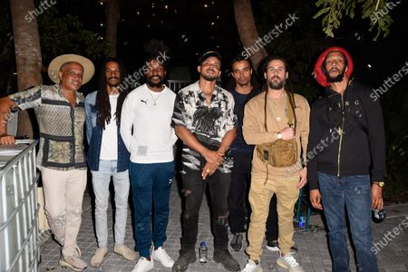 Leighton Paul Walsh, known as Walshy Fire, center, and Julian Marley, right. Backstage after the Major Lazer concert