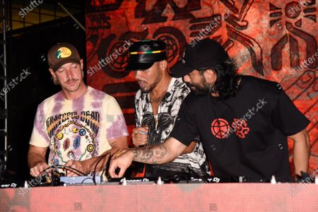 Thomas Wesley Pentz, known as Diplo, from left, Leighton Paul Walsh, known as Walshy Fire and Christopher Leacock, known as Jillionaire of Major Lazer in concert