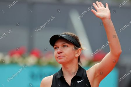 Simona Halep of Rumania celebrates after defeating Saisai Zheng of China 6-0, 6-4 during their match at the Madrid Open tennis tournament in Madrid, Spain