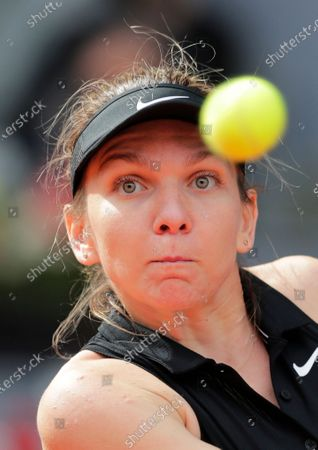 Simona Halep of Rumania returns the ball to Saisai Zheng of China during their match at the Madrid Open tennis tournament in Madrid, Spain