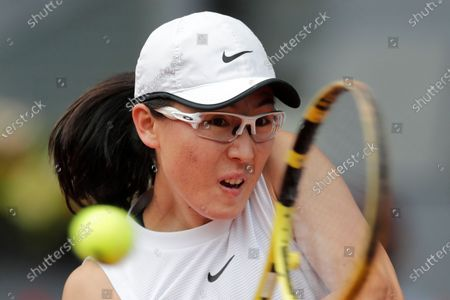 Saisai Zheng of China returns the ball to Simona Halep of Rumania during their match at the Madrid Open tennis tournament in Madrid, Spain