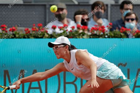 Stock Photo of Saisai Zheng of China returns the ball to Simona Halep of Rumania during their match at the Madrid Open tennis tournament in Madrid, Spain