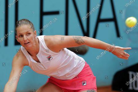 Karolina Pliskova of the Czech Republic returns the ball to Anastasia Pavlyuchenkova of Russia during their match at the Madrid Open tennis tournament in Madrid, Spain