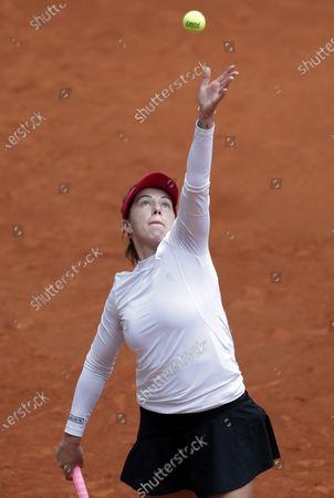 Stock Picture of Anastasia Pavlyuchenkova of Russia prepares to serve to Karolina Pliskova of the Czech Republic during their match at the Madrid Open tennis tournament in Madrid, Spain
