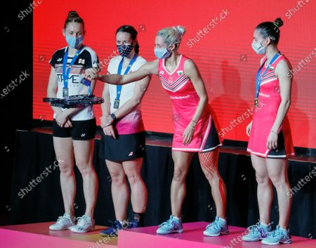 Gabriela Stoeva (2-R) and Stefani Stoeva (R) of Bulgaria take their gold medals from a drone as silver medalists Cloe Birch and Lauren Smith of England stand on the podium after  the women's doubles final match at the European Badminton Championships in Kiev, Ukraine, 02 May 2021.