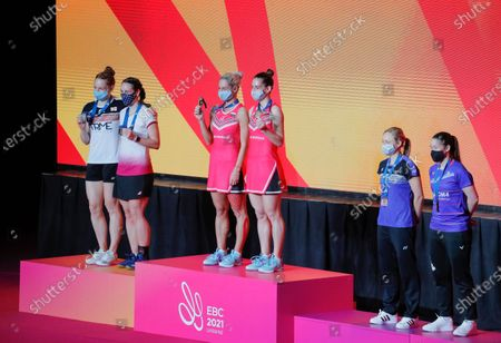(L-R) Silver medalists Line Cloe Birch and Lauren Smith of England, gold medalist Gabriela Stoeva and Stefani Stoeva of Bulgaria and bronze medalists Selena Piek and Cheril Seinen of Netherlands celebrate on the podium after the women's doubles final match at the European Badminton Championships in Kiev, Ukraine, 02 May 2021.