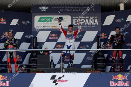Stock Photo of Winner Italian MotoE rider Alessandro Zaccone (C) of Octo Pramac MotoE celebrates next to second placed Swiss rider Dominique Aegerter (L) and third placed Spanish rider Jordi Torres (R) after the Spanish Motorcycling Grand Prix at Jerez racetrack in Jerez de la Frontera, southern Spain, 02 May 2021.