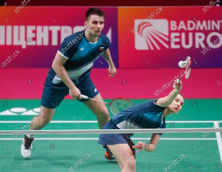 Russia's Alina Davletova and Rodion Alimov compete against England's Marcus Ellis and Lauren Smith during the mixed doubles final match at the European Badminton Championships in Kyiv, Ukraine, . Alina Davletova and Rodion Alimov went on to win the gold medals