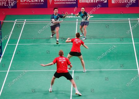 Russian's Alina Davletova and Rodion Alimov, top, compete against England's Marcus Ellis and Lauren Smith during the mixed doubles final match at the European Badminton Championships in Kyiv, Ukraine, . Alina Davletova and Rodion Alimov went on to win the gold medals