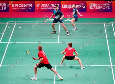 Russia's Alina Davletova and Rodion Alimov, top, compete against England's Marcus Ellis and Lauren Smith during the mixed doubles final match at the European Badminton Championships in Kyiv, Ukraine, . Alina Davletova and Rodion Alimov went on to win the gold medals