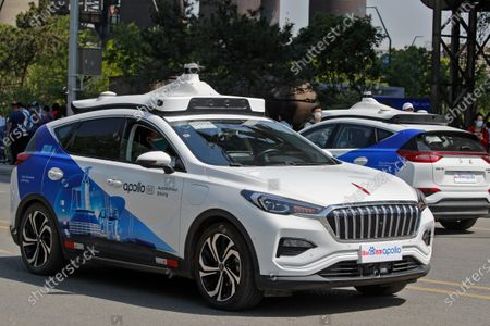 Baidu Apollo Robotaxis move on a street at the Shougang Park in Beijing, . Chinese tech giant Baidu rolled out its paid driverless taxi service on Sunday, making it the first company that commercialized autonomous driving operations in China