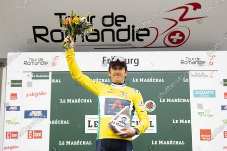 Britain's Geraint Thomas of team Ineos Grenadiers celebrates in his yellow jersey on the podium after winning the 74th Tour de Romandie cycling tour, Fribourg, Switzerland, 02 May 2021.