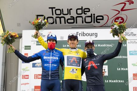 Britain's Geraint Thomas of team Ineos Grenadiers celebrates in his yellow jersey on the podium after winning the 74th Tour de Romandie cycling tour, Fribourg, Switzerland, 02 May 2021. Geraint is flanked by third placed Italian Fausto Masnada (L) of team Deceuninck-Quick-Step and second placed Australian Richie Porte (R) of team Ineos Grenadiers.