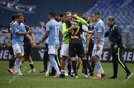 Lazio players greet their ex-teammate Genoa's Milan Badelj (C) after the Italian Serie A soccer match between SS Lazio and Genoa CFC at the Olimpico stadium in Rome, Italy, 02 May 2021.