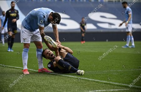 Genoa's Milan Badelj (bottom) reacts during the Italian Serie A soccer match between SS Lazio and Genoa CFC at the Olimpico stadium in Rome, Italy, 02 May 2021.